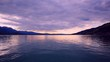 Beautiful panorama sunset view of lake Thun (Thunersee) and mountains of Swiss Alps from ship in Switzerland, Europe