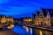 canvas print picture - View of Graslei, Korenlei quays and Leie river in the historic city center in Ghent (Gent), Belgium. Architecture and landmark of Ghent. Night cityscape of Ghent.