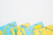 canvas print picture top view of blue and yellow stationery isolated on white