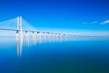 Vasco da Gama Bridge mirrored on water, Lisbon, Portugal