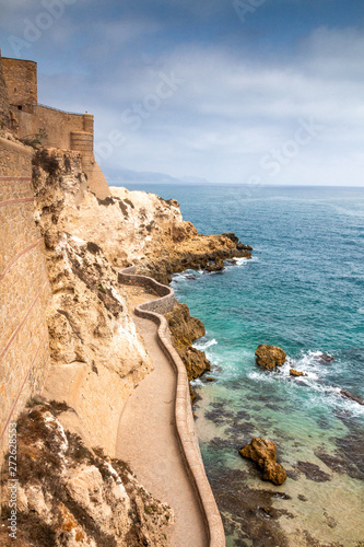 Fortress and city walls in Melilla, Spanish province in Morocco. The rocky coast of the Mediterranean Sea.