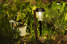 Beautiful Lamp In The Garden. Lamp With Solar Battery