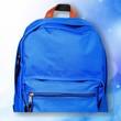 Leinwandbild Motiv Blue school bag on background