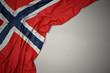 Leinwandbild Motiv waving national flag of norway on a gray background.