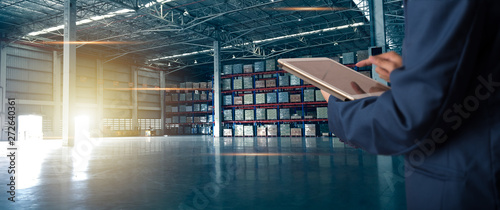 Fotografiet Businessman manager using tablet check and control for workers with Modern Trade warehouse logistics
