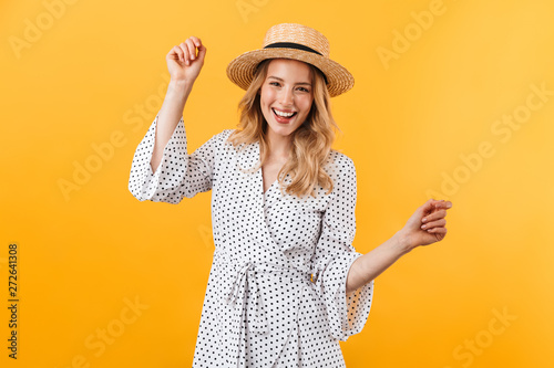 Fotografija  Beautiful young blonde woman wearing summer dress