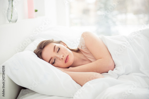Fototapeta Portrait of pretty cute youngster hair hairstyle brunette student tired serenity day dream close eyes lying bed textile in light apartment satisfied glad tranquil touch cheeks head wear underwear obraz na płótnie