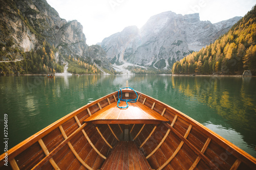Montage in der Fensternische Khaki Traditional rowing boat at Lago di Braies in the Dolomites