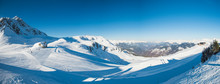 Panoramic View Across Snow Covered Alpine Mountain Range
