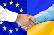 canvas print picture - Business handshake on the background of two flags. Men handshake on the background of the European Union and Ukraine flag. Support concept