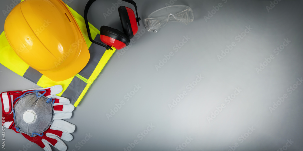 Fototapety, obrazy: work safety items of construction industry on gray background with copy space