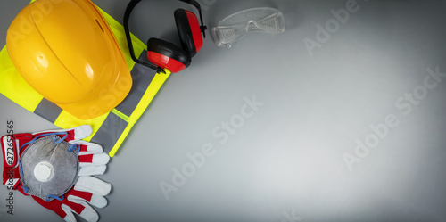 Poster Montagne work safety items of construction industry on gray background with copy space
