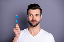 Close Up Photo Amazing He Him His Macho Perfect Ideal Appearance Advising Buy Buyer Hand Arm Novelty Plastic Personal Equipment Tooth Brush Toilet Wear Casual White T-shirt Isolated Grey Background