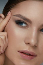 Beauty Face Makeup. Woman With Beautiful Eyes And Eyebrows