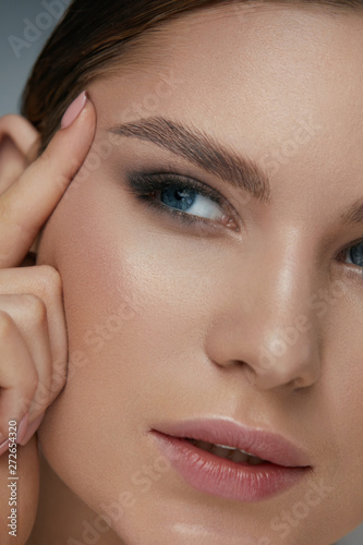 Beauty face makeup. Woman with beautiful eyes and eyebrows Canvas Print