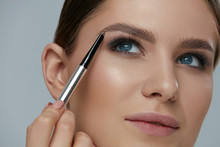 Eyebrow Makeup. Beauty Model Shaping Brows With Brow Pencil