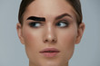 Beauty makeup. Woman coloring eyebrow with brow gel tint