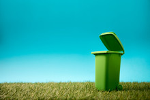 Green Recycle Bin On Green Gra...