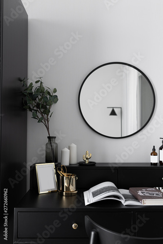 Obraz Black and white luxury feel dressing table corner in modern scandinavian style with gold circular lamp decorated / interior design concept / scandinavian interior - fototapety do salonu