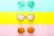 Leinwandbild Motiv Modern sunglasses on colorful background
