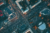Fototapeta Miasto - Aerial top view of city asphalt roads with lot of vehicles or car traffic and buildings, modern urban intersections and junctions in midtown