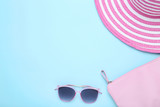 Beach hat with bag and sunglasses on blue background - 272663742