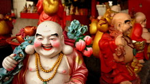 Smiling Buddha Statues At Chinese Temple