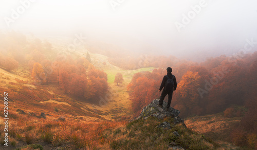 Blanc Man stands on background of autumn landscape
