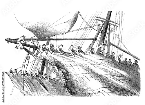 Fototapeta Sailors climbing on the masts recover and reduce the sails against the strong wi