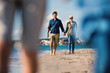 canvas print picture Young couple walking outdoors on beach, holding hands.