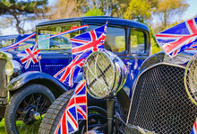 Vintage Cars Decorated With British Union Jack Flags (selective Focus)