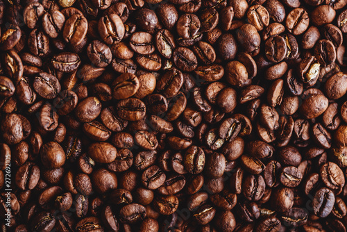 Café en grains Coffee grains. Background of roasted coffee beans brown. layout. Flat lay.
