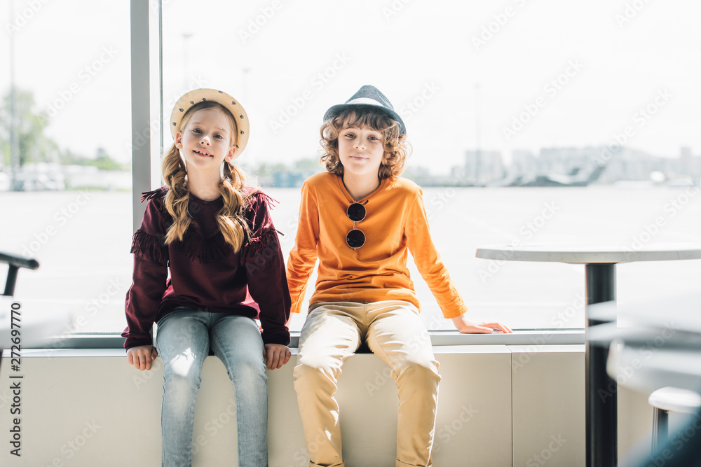 Fototapety, obrazy: adorable preteen kids sitting on window during daytime and looking at camera