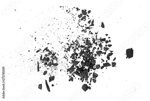 Fotoposter Brandhout textuur Small pieces of charcoal dust on white background, top view.