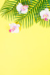 canvas print picture Tropical palm leaves and orchid flowers.