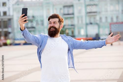 Hello world  Man taking selfie photo smartphone  Streaming
