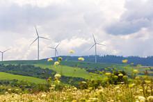 Wind Turbines On Beautiful Sunny Summer Autumn Mountain Landsape.