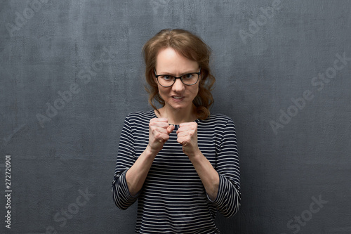 Portrait of furious girl with fists clenched Wallpaper Mural