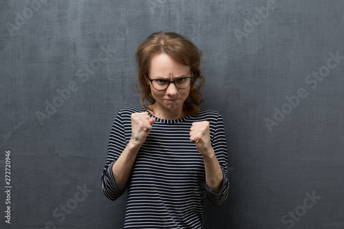 Portrait of furious young woman Wallpaper Mural