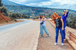 Three happy, beautiful girls vote on the road