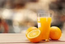 Orange Juice In Glass On Background