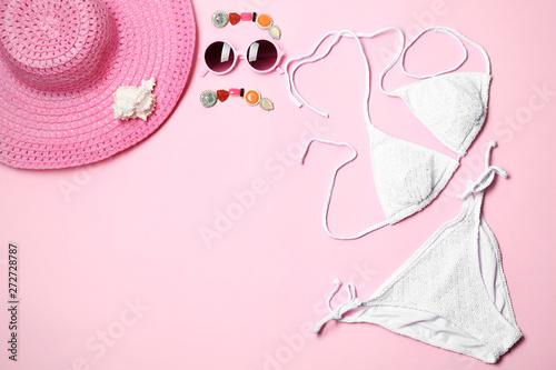 Obraz na plátne Flat lay composition with stylish bikini on color background