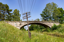 Old Destroyed Concrete Overpass Over The Railway Line. Old Railway Line With A Telegraph Line.