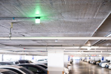 Close Up Of Green Light In Car Parking Garage Area Is The Car Park RFID Solution Management System Technology.