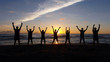 Sport team silhouette on the beach pose 3