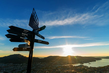 Beautiful Blue Sky And Sunset With Signpost On Mount Floyen. The Sign Describe Distance Between Here To The Famous City In The World. Bergen, Norway