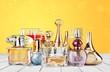 Leinwandbild Motiv Aromatic Perfume bottles on white wooden desk at wooden background