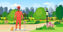 Male Street Cleaner Holding Broom And Dustpan African American Man Sweeping Garbage In Scoop Cleaning Service Concept City Urban Park Cityscape Background Full Length Flat Horizontal