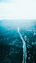 Aerial View Of Road And Forest In Snow