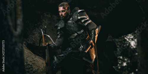 Canvas Print Knight with sword and crossbow
